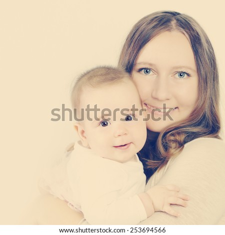 Happy little baby and mother - stock photo
