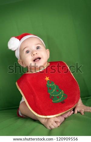 Happy little baby in Santa Hat and Christmas Bib - stock photo