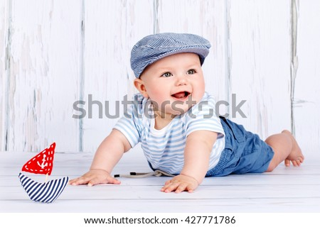 Happy little baby sailor - stock photo