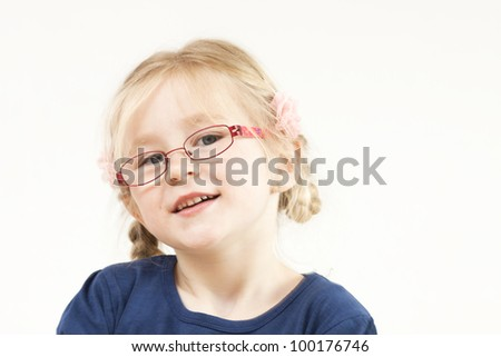 Happy little blond girl with glasses - stock photo