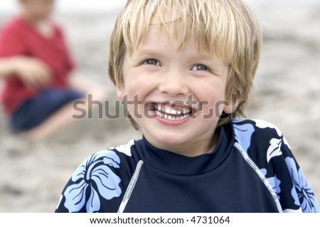Happy Little Boy at the Beach - stock photo
