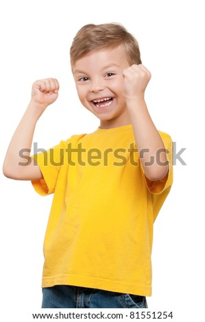 Happy little boy celebrating success over white background - stock photo