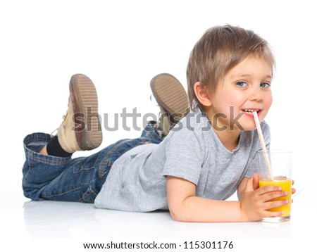 Happy little boy drinking orange juice. Isolated over white background. - stock photo