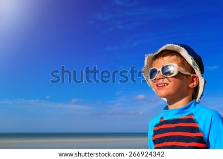happy little boy enjoying vacation at the sea beach - stock photo