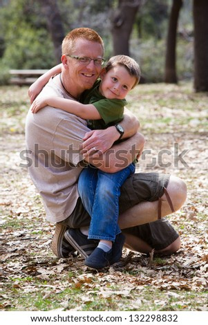 Happy little boy hugging his father - stock photo