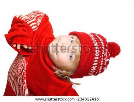 Happy little boy in red hat and sweater isolated on white background - stock photo