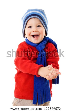Happy little boy in winter clothes, isolated on white - stock photo
