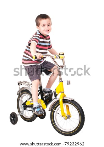 Happy little boy on bike isolated on white - stock photo