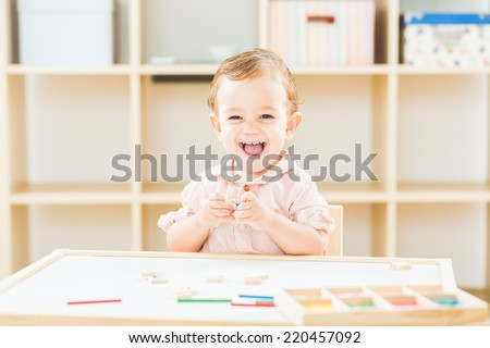 happy little boy playing with numbers and sticks at the nursery school - stock photo