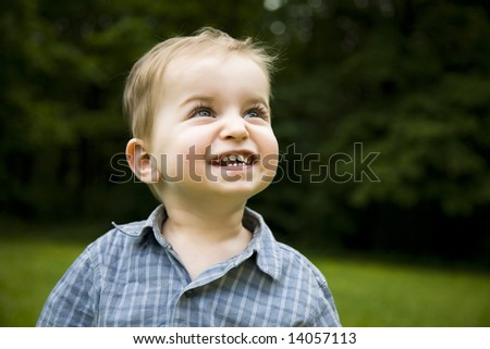 Happy Little Boy Relaxing Outdoors - stock photo