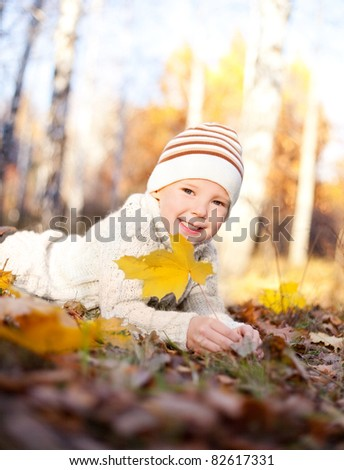 happy little boy spending time outdoor in autumn the park - stock photo