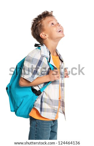 Happy little boy with backpack looks into up isolated on white background - stock photo