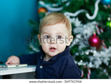 Happy Little boy with blonde hair at home - stock photo