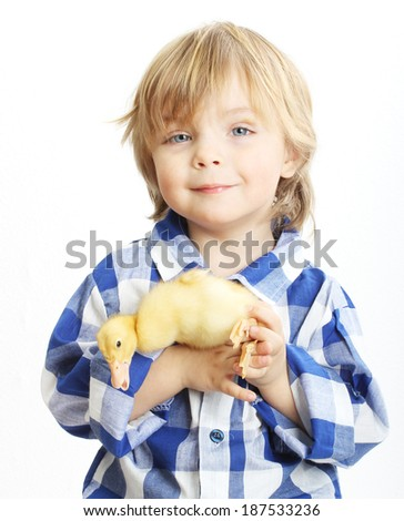 Happy little boy with cute duckling isolated on white background - stock photo