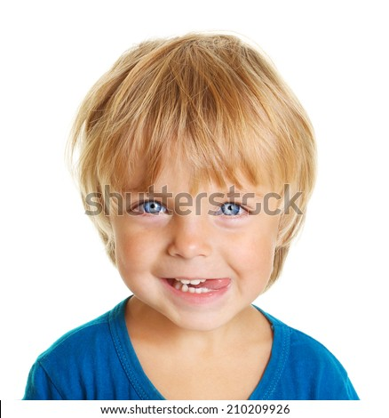 Happy little boy with tongue licking lips isolated on white background - stock photo