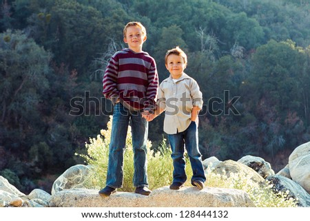 happy little boys holding hands - stock photo