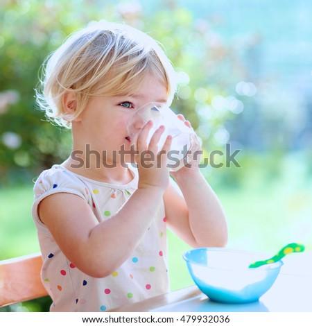 Curly Blonde Hair Boy Eating Cake