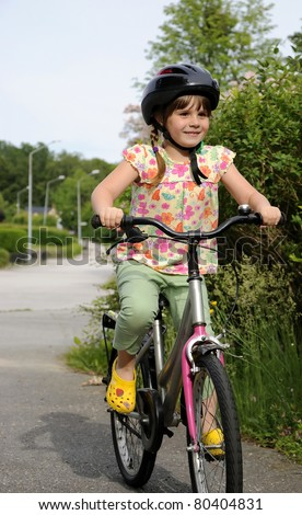 Happy little cyclist - stock photo