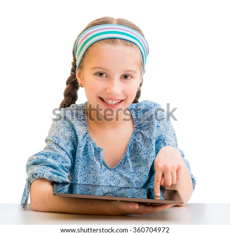 Happy little girl and her  tablet - stock photo