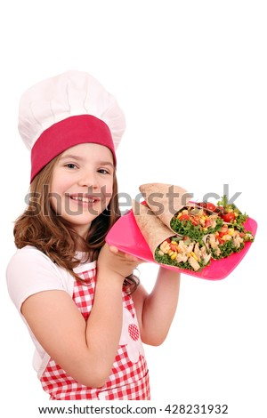 Happy little girl cook with burritos on plate - stock photo