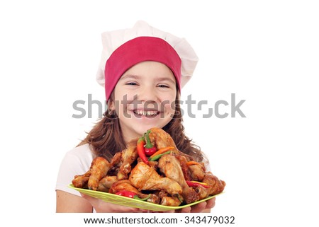happy little girl cook with chicken drumsticks - stock photo