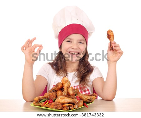 happy little girl cook with ok hand sign and chicken drumstick   - stock photo