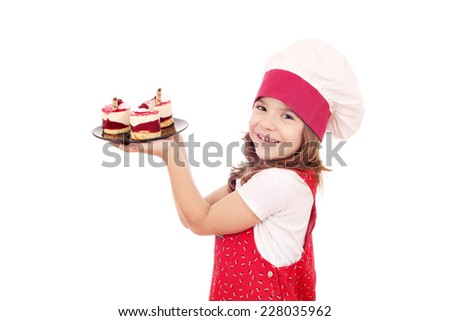 happy little girl cook with raspberry cake