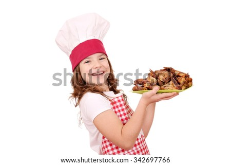 happy little girl cook with roasted chicken wings - stock photo