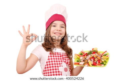 happy little girl cook with seafood and ok hand sign