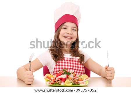 happy little girl cook with seafood ready for lunch - stock photo