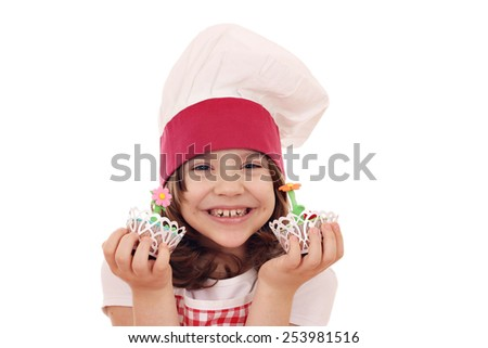 happy little girl cook with spring flower muffin - stock photo