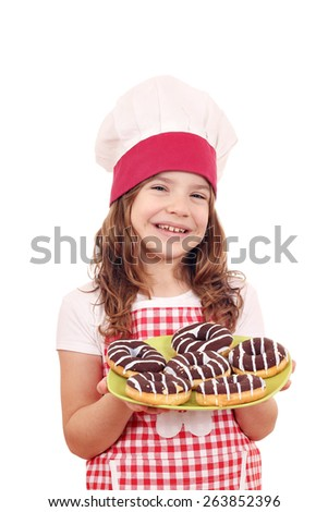 happy little girl cook with sweet chocolate donuts - stock photo