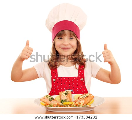 happy little girl cook with thumb up and salmon seafood - stock photo