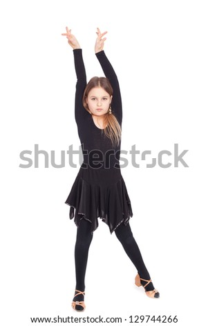 Happy little girl dancing isolated on white background - stock photo