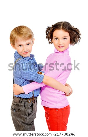Happy little girl embracing a cute boy. Children. Isolated over white. - stock photo