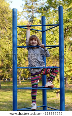 happy little girl fun on playground - stock photo