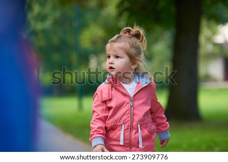 happy  little girl have fun in park