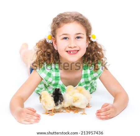 Happy little girl holding baby chickens - isolated white background