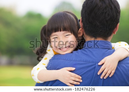 happy little girl hugging embracing her father - stock photo