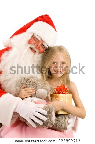 Happy Little Girl Hugs Santa with Christmas  Gift at the White Background