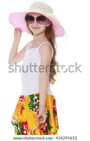 Happy little girl in a pink hat and big sunglasses. Close-up - stock photo