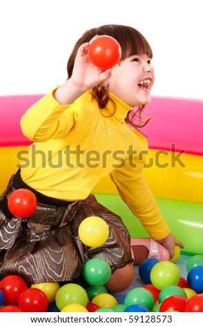 Happy little girl in group colourful ball. Isolated. - stock photo