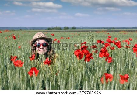 happy little girl in meadow spring season - stock photo