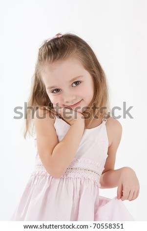 Happy little girl in pink dress on white background. - stock photo