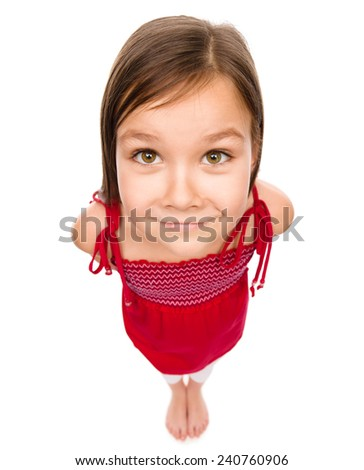 Happy little girl in red dress, fisheye portrait, isolated over white - stock photo