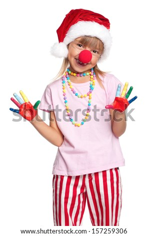 Happy little girl in Santa hat with paints on hands and red clown nose isolated on white background - stock photo