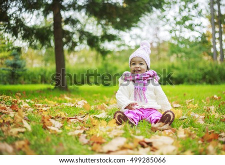 happy little girl in the autumn park