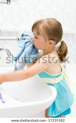happy little girl in toilet - stock photo