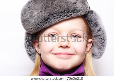 Happy little girl in winter hat . - stock photo