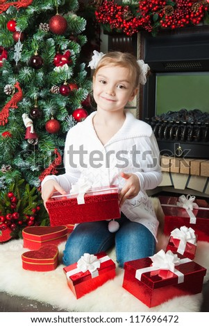 Happy little girl in with gifts